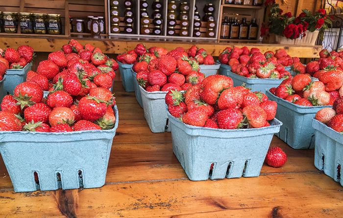 Fresh farm stand strawberries in Riverhead, NY. Photo by Alyson Goodman.